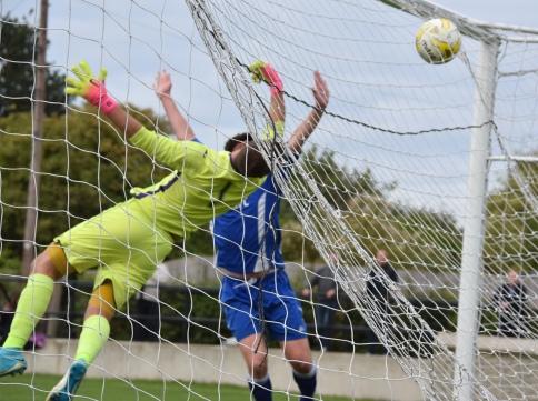 Joe Cheesman slices the ball into the net...