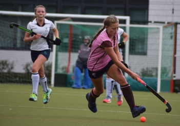 Charlotte Elms dribbles up the pitch