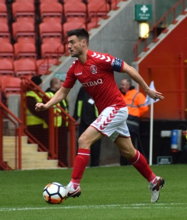 Skipper Johnnie Jackson in possession