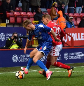 Chris Solly and Riley-Cooke fight for possession