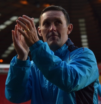Lee Hodges applauds the away support