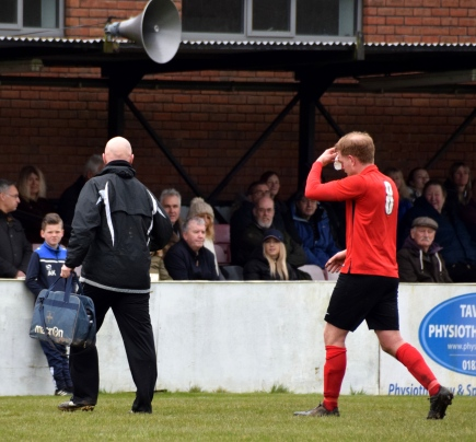 Dave Hallett leaves the pitch after a knock