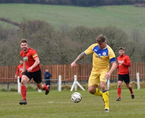 Glyn Hobbs goes through on goal...
