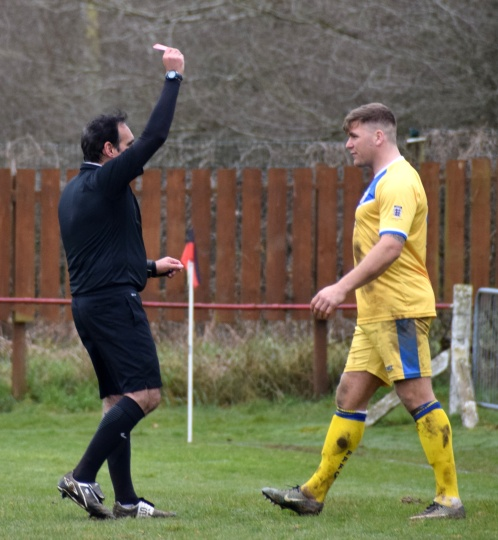 ...the ref is unimpressed and sends him off.