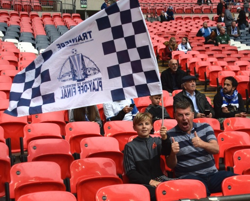 A young Tranmere fan and his dad get ready for the game...