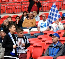 Two young Boreham Wood fans find their seats