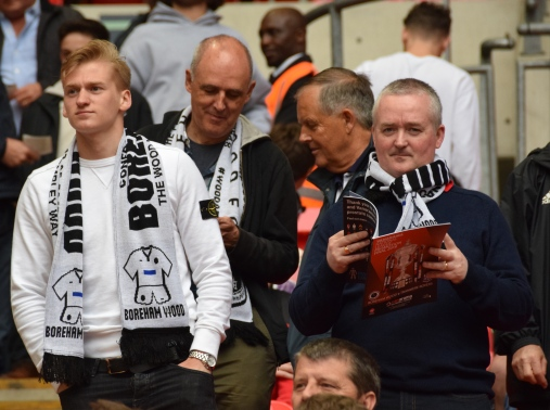 Boreham Wood supporters get to grips with the reading material