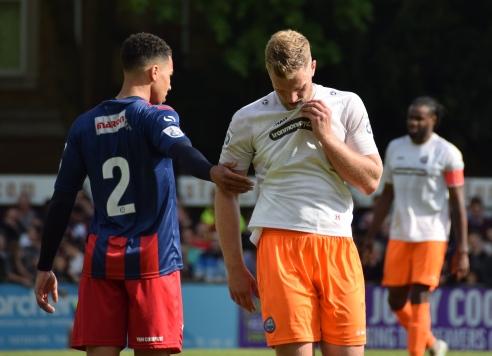 Ben Wynter grabs a hold of Joshua Hill...