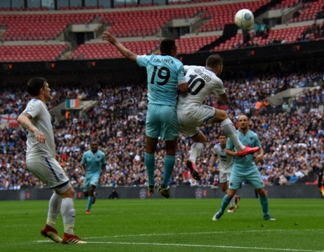 James Norwood and Angelo Balanta compete in the air