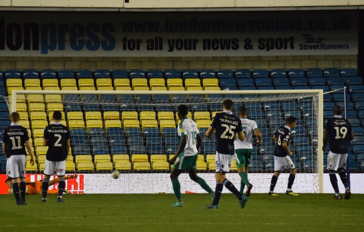 Williams celebrates as the ball nestles in the net