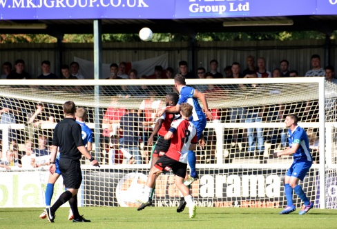 Simon Walton heads back across goal