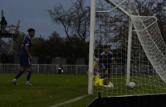 Williams looks on as the ball rolls into the net
