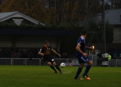 Mickey Demetriou chips into the box