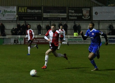 Danny Mills and Harry Taylor race for the ball