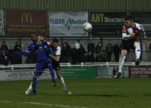 Harvey Bradbury scraps for the ball
