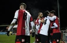 Woking players celebrate