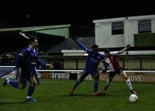 Ijaha and Hodges battle for possession