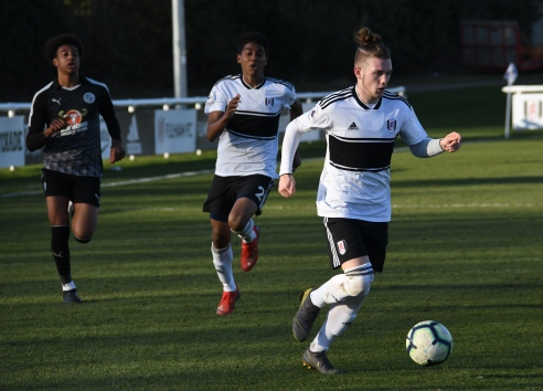 Harvey Elliott drives at the defence