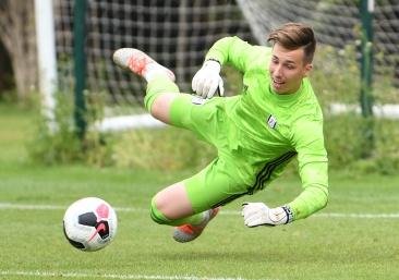 Luca Ashby-Hammond claims the ball
