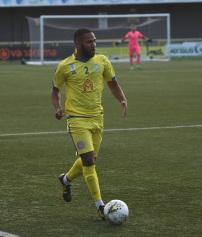 Mal Robinson advances with the ball