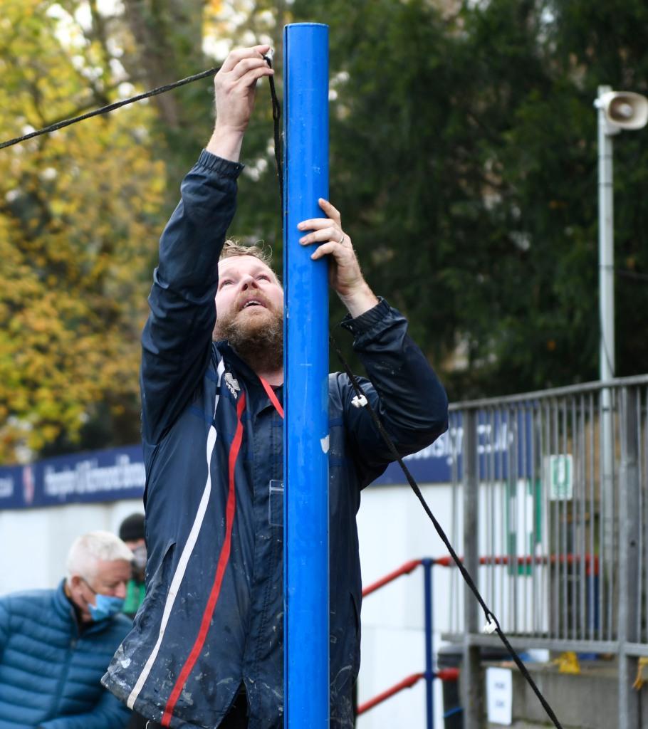 Groundsman Richard sets up the behind-goal camera